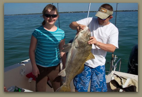 Kids catch thirty pound fish while Fishing Charter Florida.