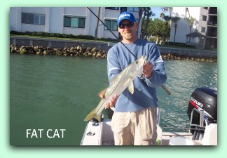 Happy anglers with a snook.