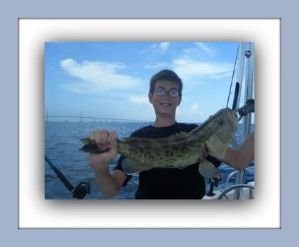 HAPPY ANGLER WITH A GAG GROUPER CAUGHT ON THE FAT CAT WITH CAPT JAY MASTERS IN ST PETE FL.