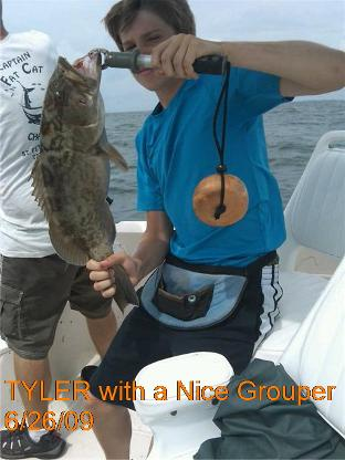 Tampa Bay charter fishing catching grouper
