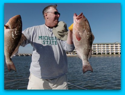 Disney area fishing charters Grig with two of his keeper Red Grouper. 11/15/2009
