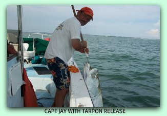 Capt Jay in the gulf of Mexico with a nice Tarpon.