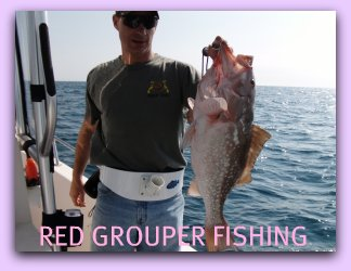 Angler Jay with his 12 pound Red Grouper caught on a 3/4 day Fat Cat Fishing charters.